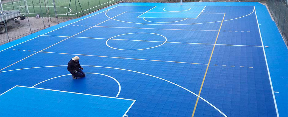 Restoration of a multisport court in a school in Rome