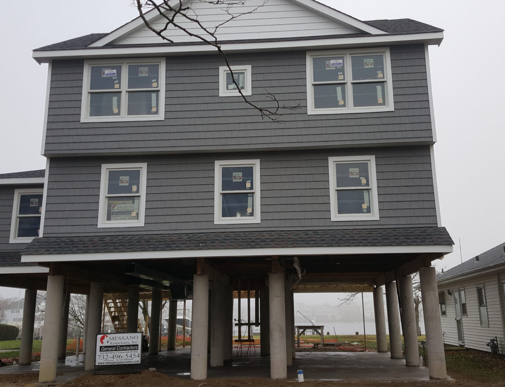 Geotub building pilings protect new jersey house from for Raising a house on pilings